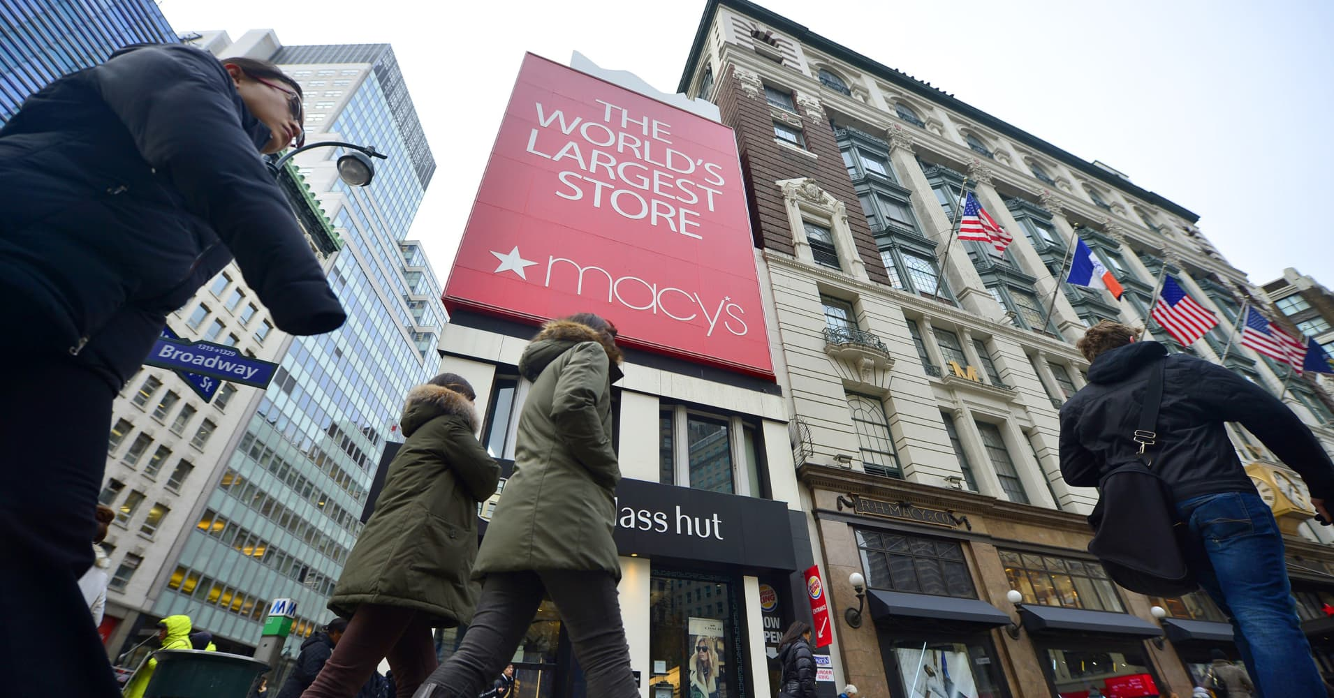 Macy's shares rise 2 percent on report retailer may build office tower on top of flagship New York store