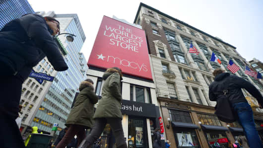 People walk past Macy's flagship store in Manhattan, New York.