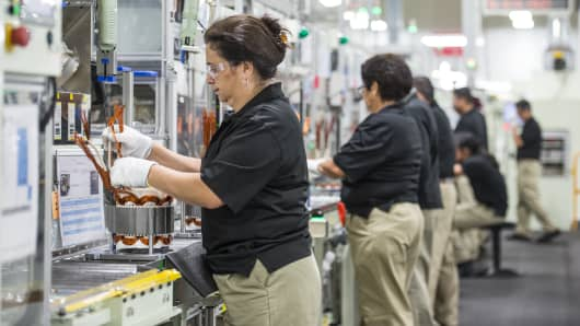 Employees Build Components For Hybrid Electric Vehicle Motors At The  Toshiba International Manufacturing Facility In Houston