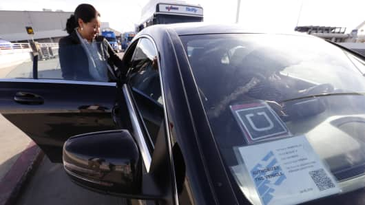 A woman takes and Uber from LAX airport in Los Angeles. Uber is partnering with Amazon to offer Amazon Original Series during Uber rides.