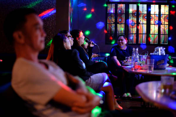Customers sing karaoke at a nighclub in Davao City in Mindanao on May 10 - the city where president-elect Rodrigo Duterte honed his crime-fighting skills. He most recently announced plans to impose a nationwide- curfew for children and may ban the serving of alcohol after midnight.
