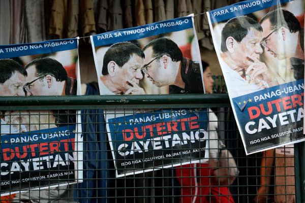 Election tarpaulins featuring Rodrigo Duterte, erected on a street in Davao City. His landslide presidential victory was built on foul-mouthed populist tirades that exposed deep voter anger at the establishment.
