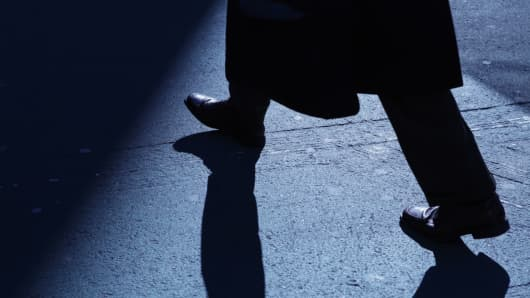 Businessman silhouette, in the shadows