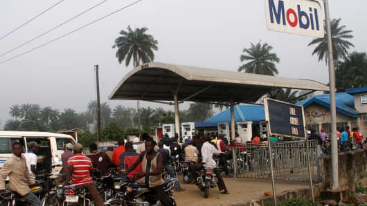 Motorists queue to buy petrol at a fuel station in Ahaoda in Nigeria's oil state in the Delta region.