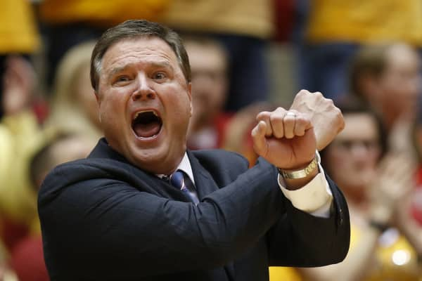 Head coach Bill Self of the Kansas Jayhawks signals a play from the bench in the first half of play against the Iowa State Cyclones at Hilton Coliseum on January 25, 2016 in Ames, Iowa.