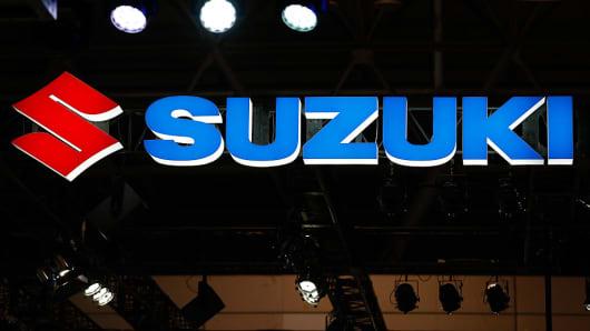 Suzuki Motor Corporation logo is shown on display at the 2016 Tokyo Auto Salon car show on January 15, 2016 in Chiba, Japan.