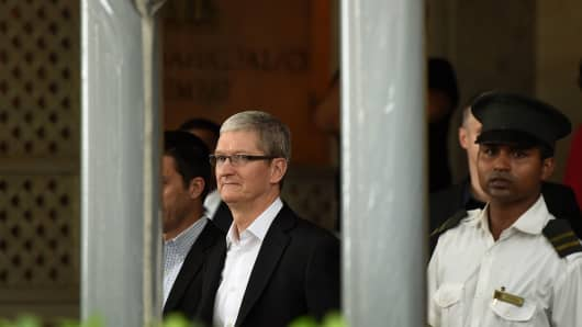 Apple chief executive Tim Cook leaves the Taj Mahal Palace hotel in Mumbai