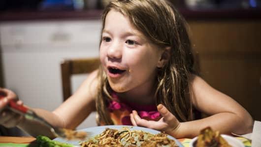Child, girl eating dinner, messy plate