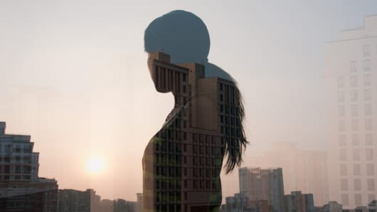 Woman silhouette with cityscape