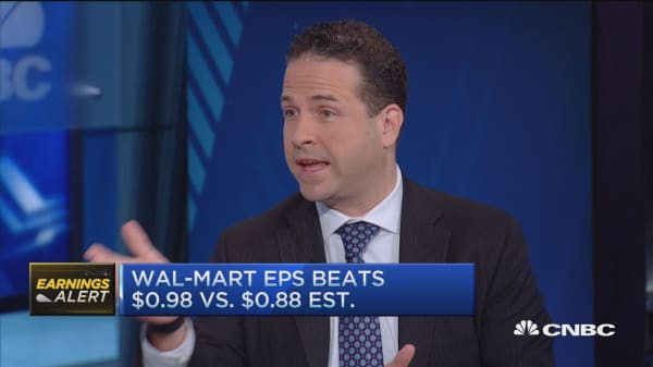 Wal-Mart beats Street by a dime