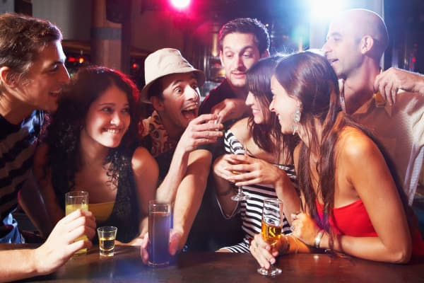 Millennials with drinks at bar