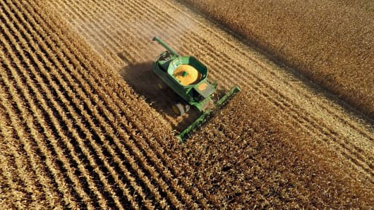Non-GMO corn is harvested with a John Deere & Co. 9670 STS combine harvester in this aerial photograph taken above Malden, Illinois.
