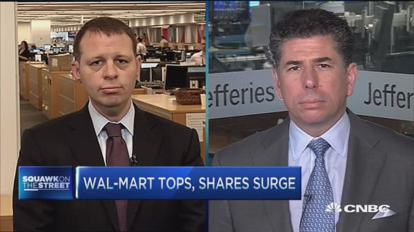 Walmart tops, shares surge