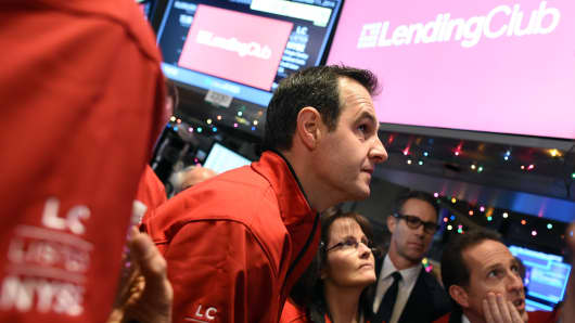 Lending Club Founder and CEO Renaud Laplanche on the floor of the New York Stock Exchange watches prices December 11, 2014 in New York.