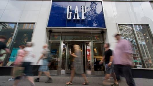 Pedestrians walk past a Gap Inc. store in New York.