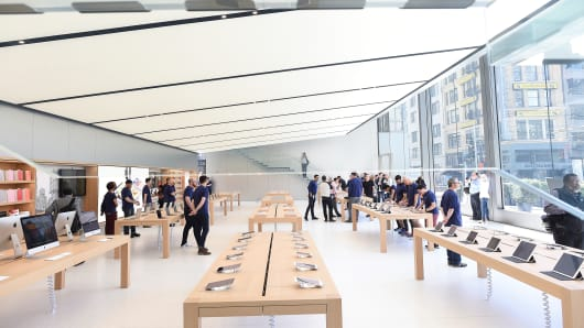 "Apple workers stand inside ""The Avenue"" section of Apple's new San Francisco store on May 19, 2016."