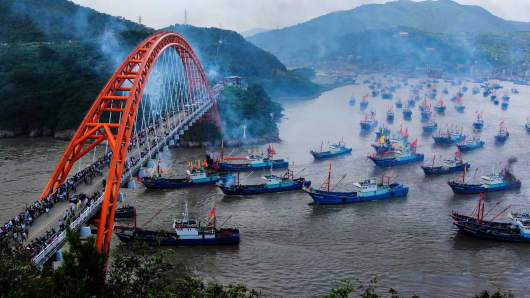 Fishing boats set off from Shipu port for fishing on September 16, 2015 in Ningbo, China. Thousands of fishing boats set sail for fishing after three and a half months fishing ban in the East China Sea.
