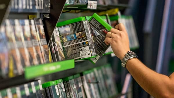 A customer reaches for a video game inside a GameStop store in San Francisco, California.