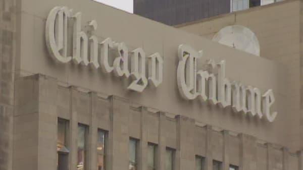 Tribune gets $70M investment, rejects Gannett's bid