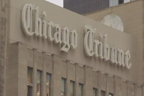 Tribune gets $70M investment, rejects Gannett's bid