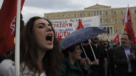 Protesters shout slogans during a demonstration against a new package of tax hikes and reforms in front of the parliament building in Athens, Greece, May 22, 2016.