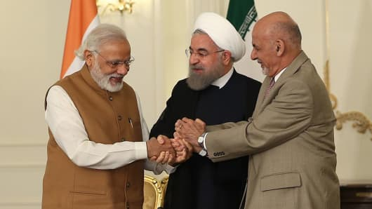 President of Afghanistan Ashraf Ghani, Prime Minister of India Narendra Modi and President of Iran Hassan Rouhani shake hands after they signed Chabahar transit agreement in Tehran, Iran on May 23, 2016.