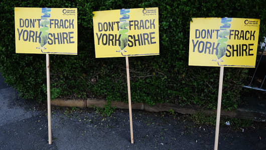 Anti fracking placards are placed against a hedge as protestors wait in the grounds of the County Hall building on May 23, 2016 in Northallerton, England.