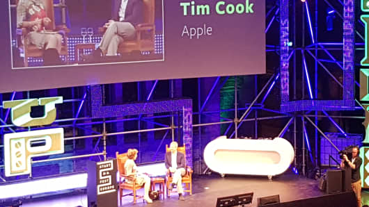 Apple chief executive Tim Cook speaking to former European Commissioner Neelie Kroes at Startup Fest on Tuesday May 24, 2016.