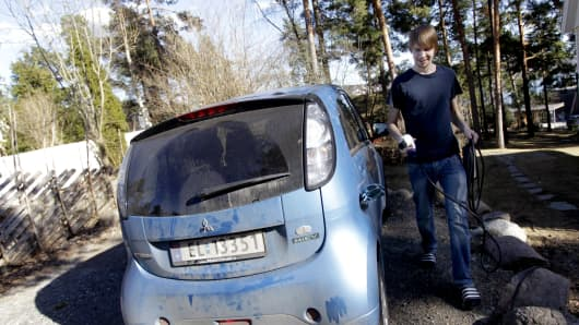 Christian Blakseth charges his electric car's batteries in Oslo, Norway.