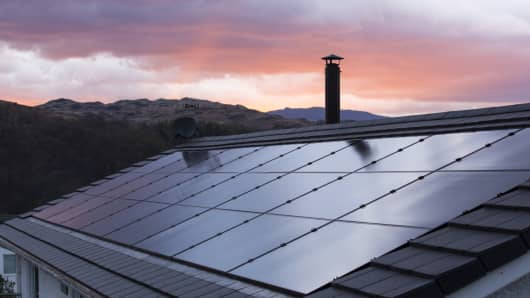 Built in solar panels on a house roof in Ambleside, Lake District, UK, at sunset.