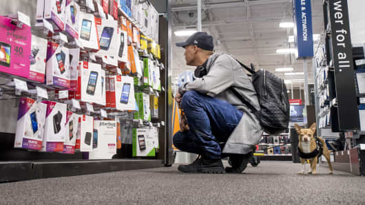 A shopper browses prepaid phone merchandise at a Best Buy store in San Francisco.