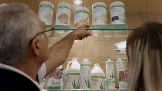 Herbalife Ltd. independent distributors look at available products before placing orders at the Los Angeles Distribution Center in Carson, California
