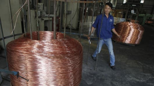 A worker labels copper products at Truong Phu cable factory in Vietnam's northern Hai Duong province, outside Hanoi.