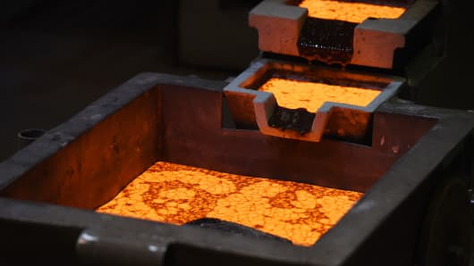 Molten gold sits to cool in molds at the Norton Gold Fields' Paddington operations 35 kilometers north-west of Kalgoorlie, Australia.