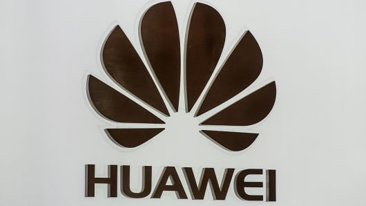 A logo sits illuminated outside the Huawei pavilion on the opening day of the World Mobile Congress at the Fira Gran Via Complex on February 22, 2016 in Barcelona, Spain.