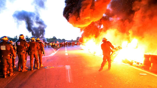 French riot police prepare to disperse workers at an oil depot blockade