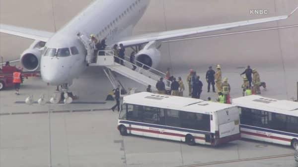 Two bomb threats disrupt travel