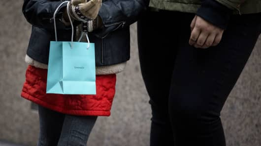 A pedestrian holds a Tiffany shopping bag in New York.