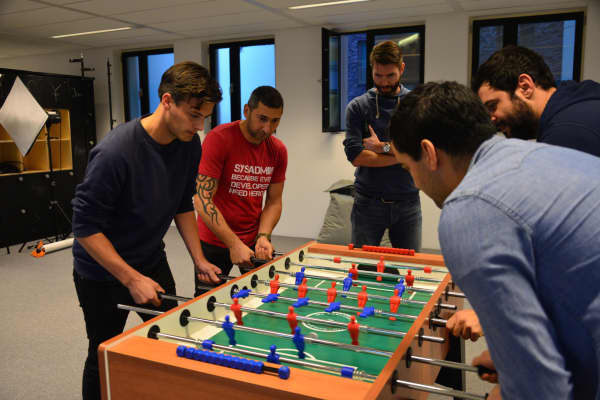 Adyen employees play table soccer in the company's Amsterdam headquarters