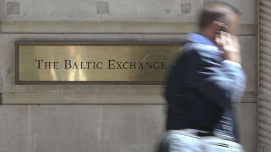 A businessman passes the Baltic Exchange in London, U.K., on Wednesday, June 16, 2010.