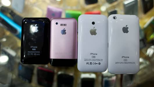 Four different sizes of imitation Apple iPhones on display at a mobile phone market, popular for selling imitation and counterfeit phones, in Shenzhen, China.