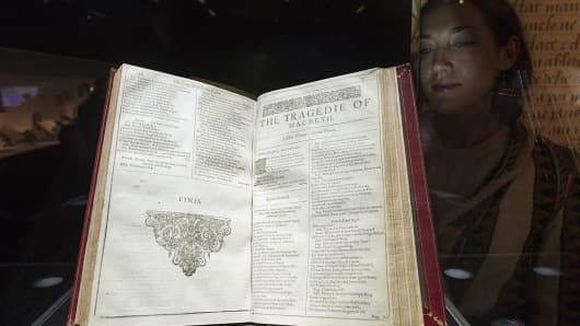 A visitor views a First Folio of William Shakespeare's Comedies, Histories, and Tragedies before it is sold for £1,874,500 at auction in London, on May 25, 2016.