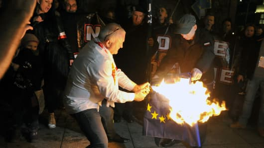 Nationalist protesters burn the European Union flag on Poland's National Independence Day in Wroclaw on November 11, 2015.