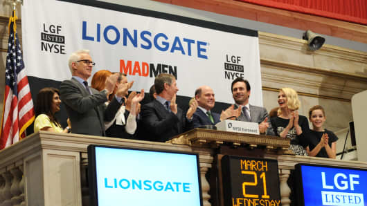The cast of the television show 'Mad Men' ring the opening bell of the New York Stock Exchange on March 21, 2012.