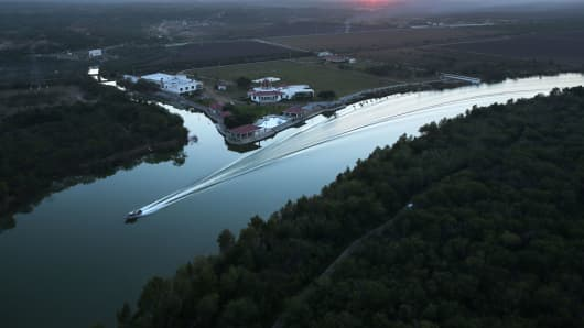 U.S. Border Patrol boat patrols along the Rio Grande (Mexico on left, U.S. on right) near McAllen, Texas.