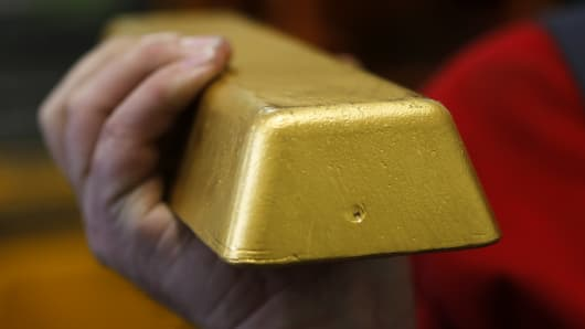 A worker holds a gold bar in the Austrian Mint (Muenze Oesterreich) headquarters in Vienna.