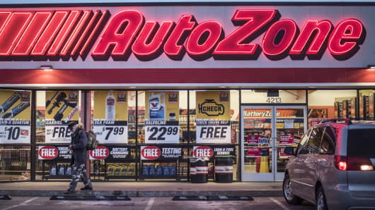 A man walks outside an AutoZone store in Albuquerque, New Mexico.