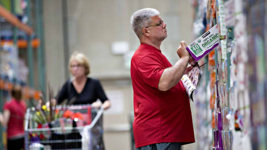 Customers browse merchandise at a Costco Wholesale store in Naperville, Illinois.