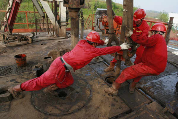 Oil workers working well