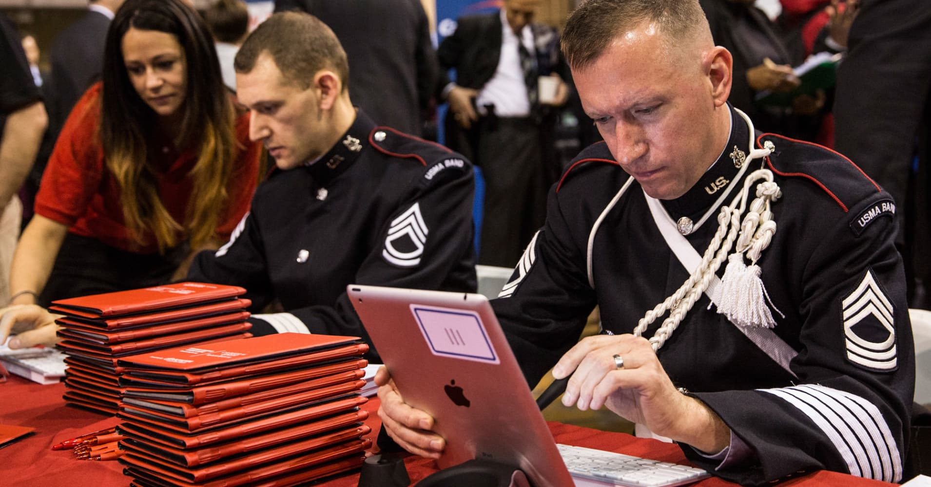 A Master Sergeant of the United States Army, fills out an application with Toyota in New York City.